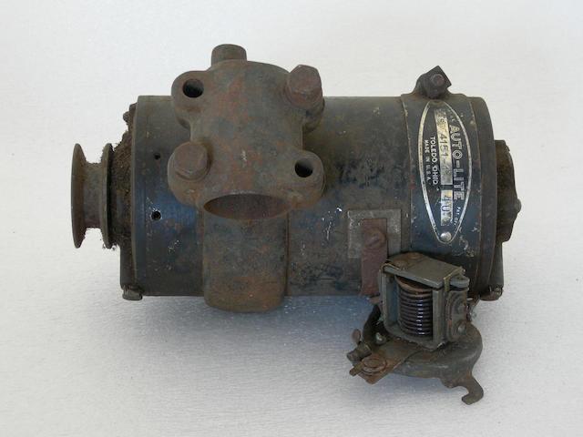 An Auto-Lite motorcycle generator,