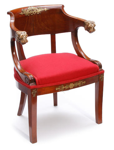 An Empire style gilt bronze mounted mahogany armchair