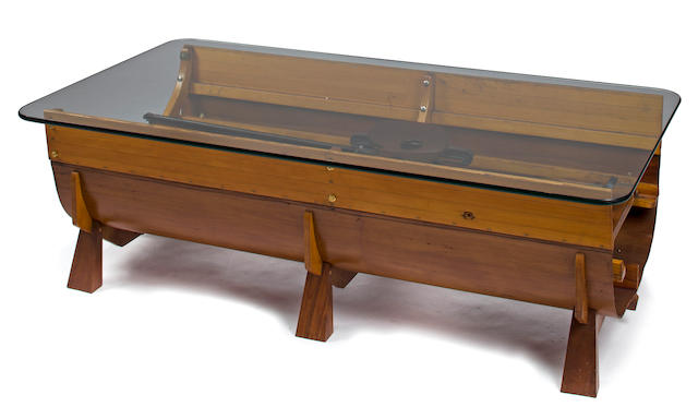 A coffe table made from the center section of a rowing shell  20th century 56 x 30 x 17 in. (142.2 x 76.2 x 43.1 cm.)