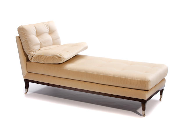 A Patrick Naggar ebonized wood and fabric upholstered chaise longue