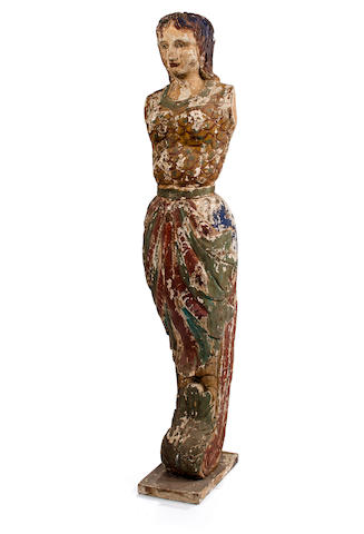 A carved and painted figurehead in the form of a mermaid <BR /> 19th century 49-1/2 x 10 in. (125.7 x 25.4 cm.)