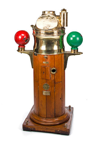 A large wood stave binnacle with brass hood<BR /> circa 1890 56 x 32 in. (142.2 x 81.2 cm.) height x width.