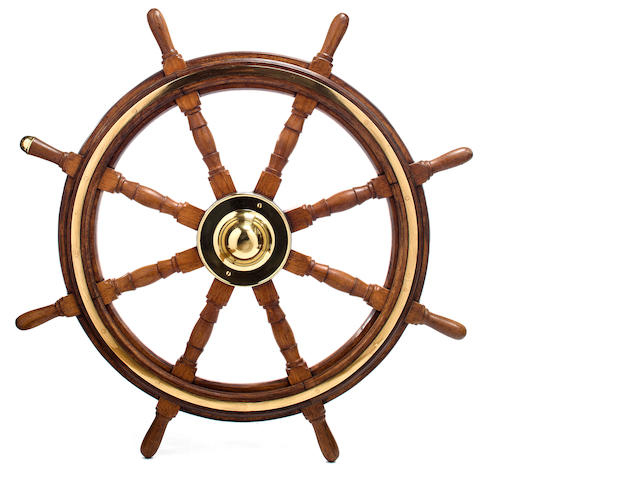 Wheel with inlaid brass trim