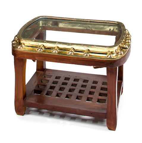A brass porthole table<BR /> 20th century 19 x 28 x 20 in. (48.2 x 71.1 x 50.8 cm.)