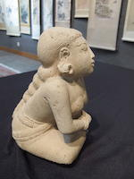 A tuff kneeling woman Majapahit period, 14th-16th century