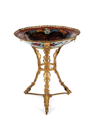 An Imari style porcelain charger mounted on a gilt metal stand<BR />fourth quarter 19th century