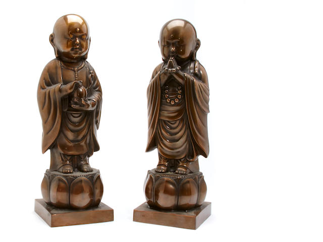 A pair of bronze buddhas