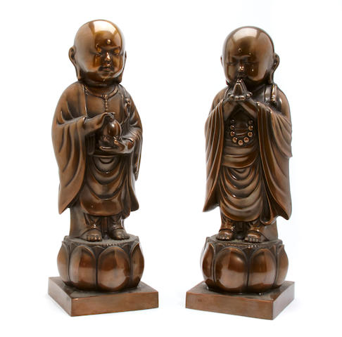 A pair of bronze buddhas