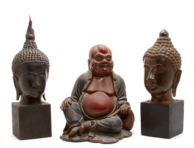 Two bronze buddha heads and a Buddha figure