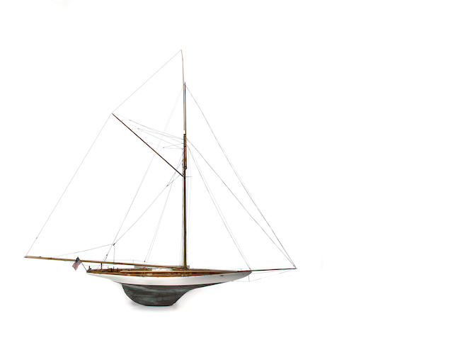 A model of the America's Cup yacht Defender<BR /> Modern, 20th century 76-1/2 x 9-1/2 x 70-1/2 in. (194.3 x 24.1 x 179 cm.) model on bracket.