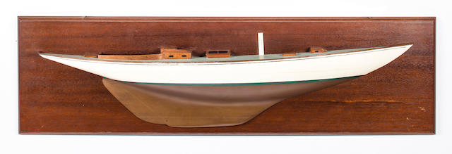 A half model of the sloop Java<BR /> 20th century 10-3/4 x 38 in. (27.3 x 96.5 cm.) backboard.