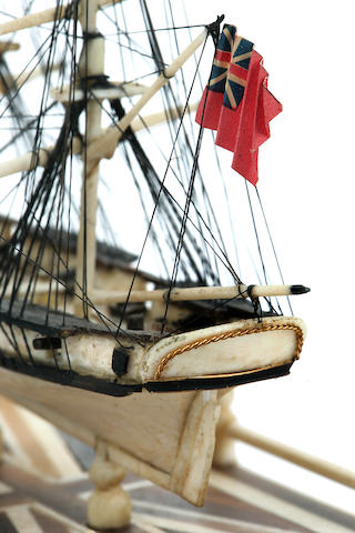 A miniature Napoleonic prisoner-of-war style bone model of a British naval brig<BR /> circa 1965 7 x 10 in. (17.8 x 25.4 cm.) height x diameter.