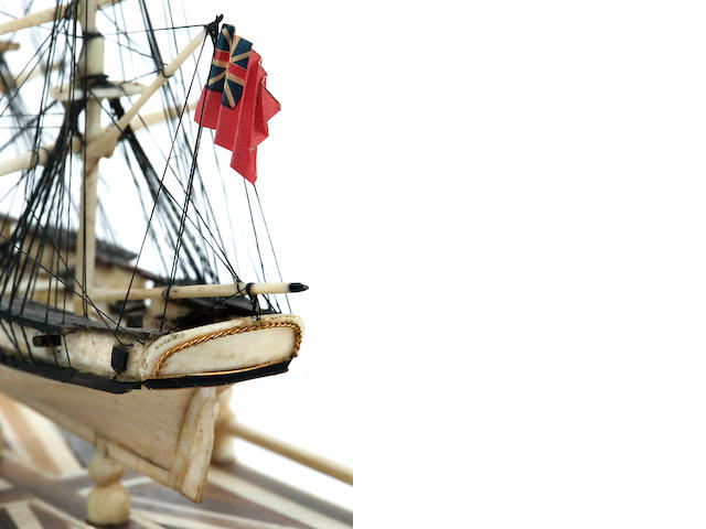 A miniature Napoleonic prisoner of war style bone model of a British naval brig<BR /> circa 1965 7 x 10 in. (17.8 x 25.4 cm.) height x diameter.