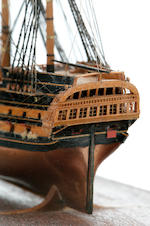 A very fine and well detailed miniature ship model of a British 70-gun ship-of-the-line<BR /> 20th century 4-7/8 x 2 x 3-7/8 in. (12.3 x 5 x 9.8 cm.) cased.