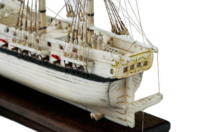 A miniature Napoleonic Prisoner of War model of a 46-gun frigate<BR /> early 19th century 10-1/2 x 5-1/2 x 8-1/4 in. (26.6 x 13.9 x 20.9 cm.) cased. length x depth x height.