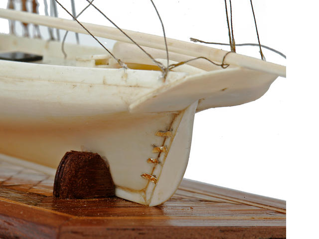 A miniature model of a gaff rigged cutter yacht<BR /> late 19th Century 9-1/4 x 5-1/4 x 7-3/4 in. (23.5 x 13.3 x 19.7 cm.) cased.