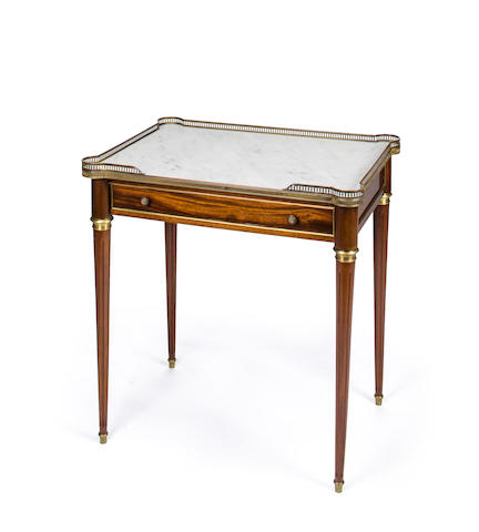 A Directoire style gilt brass mounted mahogany side table with white marble top<BR />circa 1900