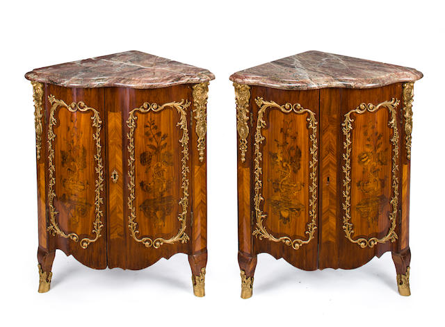A pair of Louis XV gilt bronze mounted tulipwood and amaranth marquetry encoignures Pierre Bernard circa 1755