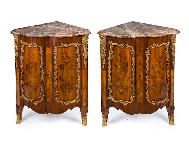 A pair of Louis XV gilt bronze mounted tulipwood and amaranth marquetry encoignures<BR />Pierre Bernard<BR />circa 1755