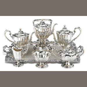 An American sterling silver six piece tea and coffee service with associated electroplated two-handled tray by William B. Durgin Co., Concord, NH, retailed by W. C. Bryant. Reed & Barton, Taunton, MA