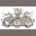An American sterling silver six piece tea and coffee service with associated electroplated two-handled tray by William B. Durgin Co., Concord, NH, retailed by W. C. Bryant<BR />Reed & Barton, Taunton, MA