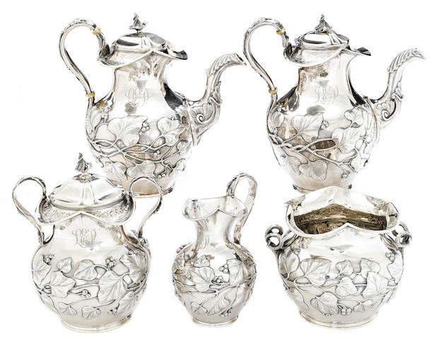 An American  coin silver five piece foliate-decorated tea and coffee service by Baldwin & Co., Newark, NJ, circa 1840-1869