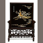 A group of two Chinese mother of pearl inlaid lacquered panels in hardwood stands