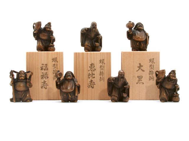 A pair of Japanese bronze figures of gaurdian gods