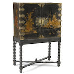 A George I chinoiserie decorated cabinet on stand <BR />18th century