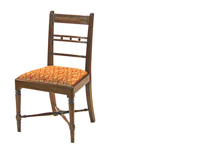 A set of four late Regency mahogany side chairs