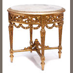 A Louis XVI style carved giltwood table de milieu with alabaster top