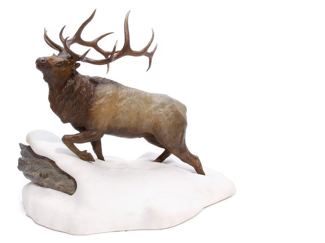 A patinated bronze figure of an elk