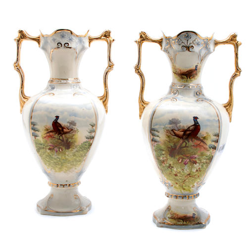 A pair of Continental transfer print porcelain two handled vases