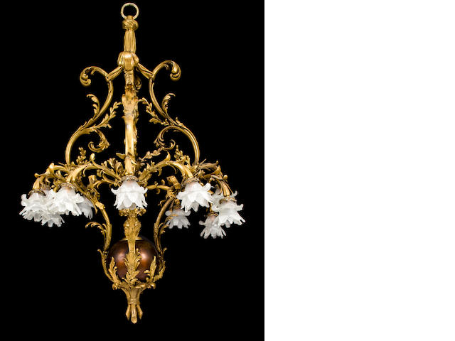 A Rococo style gilt-bronze and marble thirteen-light chandelier