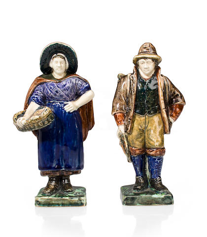 A pair of Rozenburg glazed earthenware figures of a fisherman and his wife<BR />late 19th century