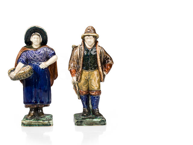 A pair of Rozenburg glazed earthenware figures of a fisherman and fishwife<BR />circa 1893