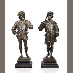 A pair of patinated bronze figures of guards. after the model by Anatole J. Guillot (French, 1865-1911)