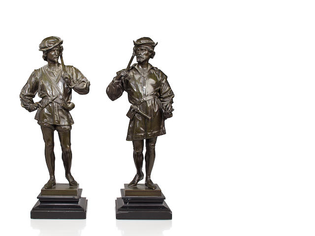 A pair of patinated bronze figures of guards<BR />after the model by Anatole J. Guillot (French, 1865-1911)