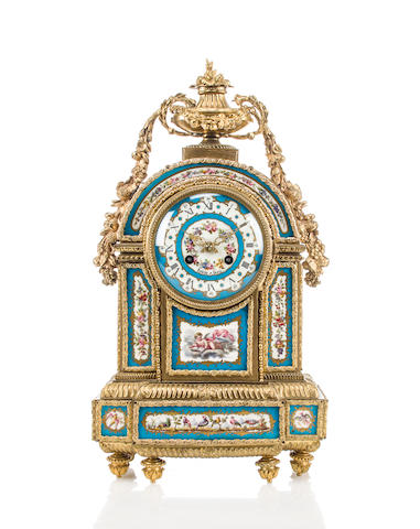 A Louis XVI style gilt-bronze-mounted porcelain mantel clock<BR />Robin a Paris