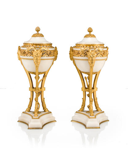 A pair of Louis XVI style gilt bronze mounted white marble covered urns<BR />late 19th/early 20th century