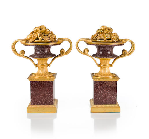 A pair of Louis XVI style gilt-bronze-mounted porphyry urns<BR />late 19th/early 20th century