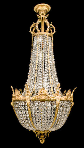 "A Louis XVI style gilt bronze and glass bead fifteen-light chandelier ""en corbeille""<BR />circa 1900"