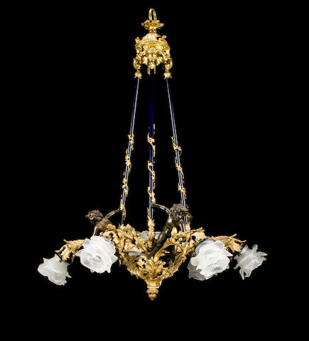 An Art Nouveau gilt and patinated bronze five-light chandelier