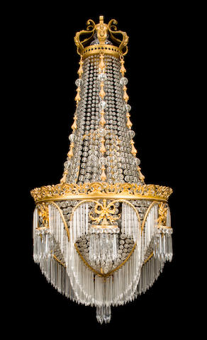 A Louis XVI style gilt-bronze and glass chandelier