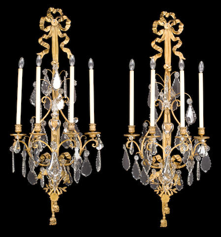A pair of Louis XVI style gilt metal and glass wall appliques