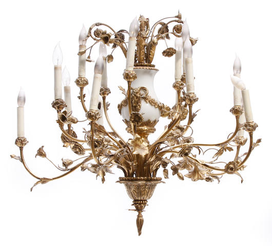 A Continental milk glass and brass fifteen light chandelier