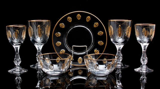 A suite of Continental gilt heightened glassware
