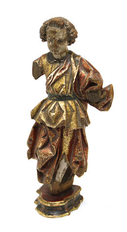 An Italian Baroque polychrome and gilt decorated carved wood figure 17th century