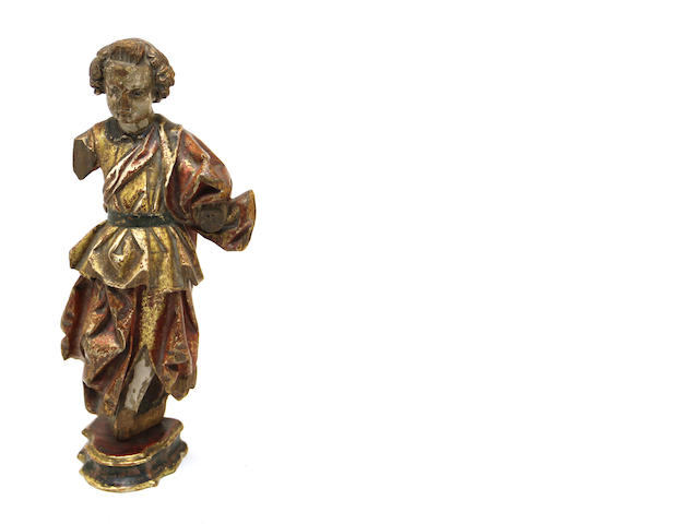 An Italian Baroque polychrome and gilt decorated carved wood figure