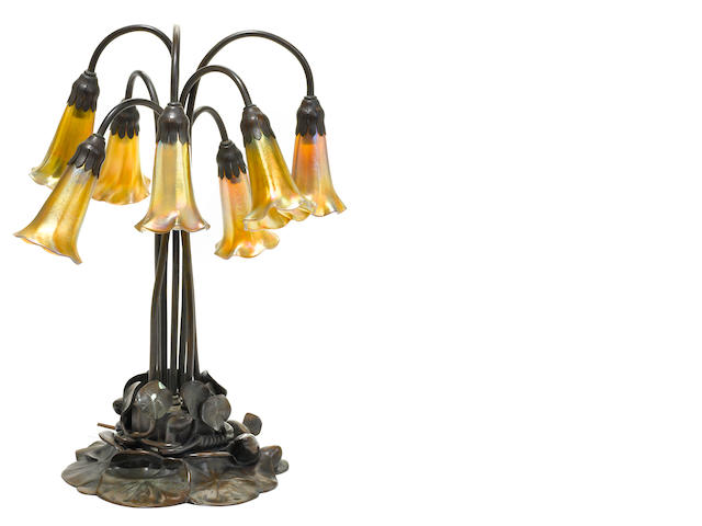 A Tiffany Studios favrile glass and patinated bronze seven light lily lamp
